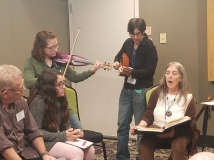 """Our own Judy Seid presenting """"Songs for Holidays and Shabbes"""" There was also a whole-group singalong at the end of the day. Click these links to see some video from the singalong: https://drive.google.com/file/d/1Mx0Aa5KjqmYZAY2sFC_aBy8BDMRjrDsu/view?usp=sharing https://drive.google.com/file/d/1XJsr73hiMcfRCYwyzHz9VPK5sPtZygZR/view?usp=sharing"""