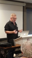 Andy Muchin delivering a presentation called American Groove